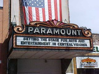 The Paramount Theater is not open currently, though judging from the marquee, it sounds like they want to open it eventually. In the meantime, though, it provides a semi-protected area for vendors. Beautiful sign, though.