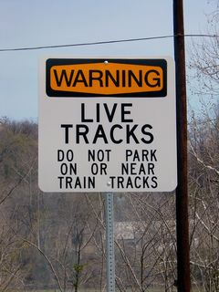 """As this is a rail line that is very much still in use, a sign reminds people not to obstruct the tracks. However, since there is no high-voltage """"third rail"""", it's perfectly safe to walk across the tracks - just as long as no train is coming."""