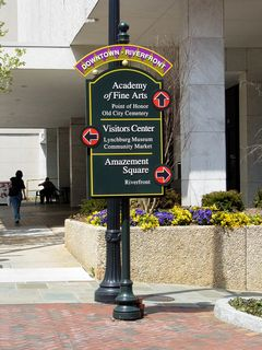 On the street in front of the Bank of the James Building is an informational sign, directing visitors on where to go to find various buildings while downtown.