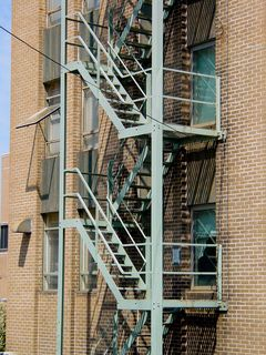 On the rear of the building is an exterior stair.