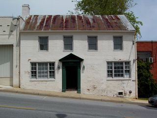 This building, vacant at the time of photography, was once the home of The Fox and Hounds, a fine dining restaurant. My family and I ate there once, when, not long after we moved to the area, our real estate agent made reservations for us there.