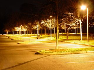 Security lighting around the main parking area at McIntire Park provides a reassuring glow, creating the appearance of an island of illumination, when compared with the darkness all around.