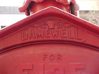 At the top is Gamewell's tested-and-true fire box logo, with the hand grabbing the lightning. This logo is associated so closely with fire boxes, in fact, that when Randix made novelty fire-box-style telephones, they used the lightning-hand logo at the top of their boxes.