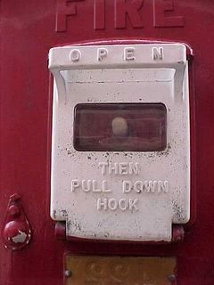 """In case of fire, pull down the cover, and pull down the hook inside. These shots are the first to give evidence to the fire box having been repainted. On the standard-issue boxes, the """"FOR FIRE"""" is painted in white, and then the """"Open then pull down hook"""" is painted in red."""