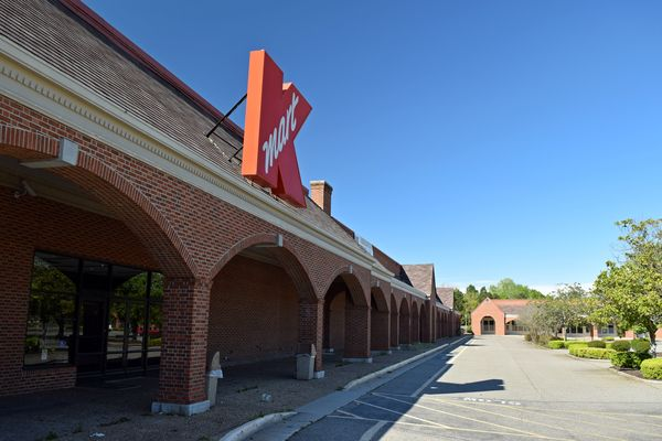 Former Kmart in Williamsburg, Virginia with colonial-style architecture, typical of many commercial buildings in the Williamsburg area.