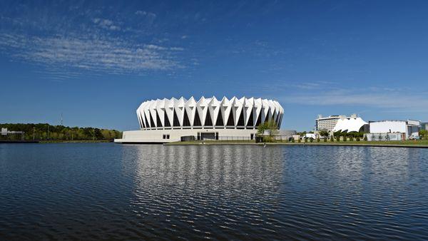 Hampton Coliseum, viewed from across Coliseum Lake, in daylight.