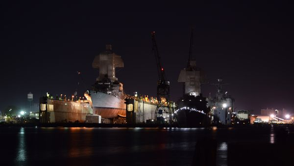 The USS Jason Dunham (left) and another ship undergoing work at the General Dynamics NASSCO facility in Norfolk. View from Portsmouth.