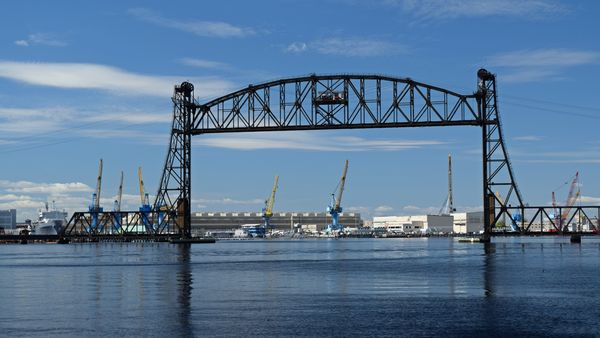 A vertical lift bridge, which carries a Norfolk Southern rail line across the Elizabeth River between Portsmouth and Chesapeake, Virginia.