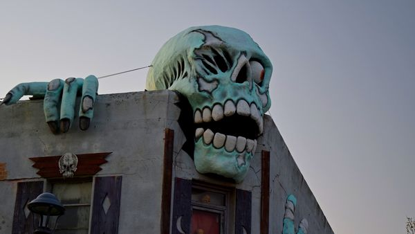Skeleton adorning the roof of Nightmare Mansion, a haunted house attraction in Virginia Beach, Virginia.