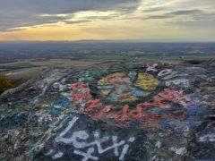 """Peace, Love, Happiness"" graffiti on High Rock."