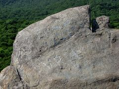 Carvings left by other hikers over the years