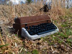 Typewriter outside of an abandoned house, 2016