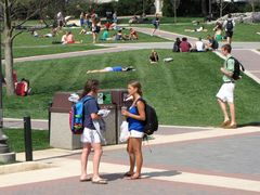 Students relax and converse on the Quad.