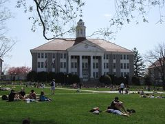 Students relax on the Quad in front of Wilson Hall.