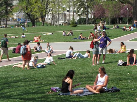Students relax and converse on the Quad. The Music Building is visible in the distance.
