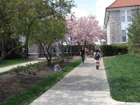 Students walk between the breezeway between Wilson and Keezell Halls and the Commons.