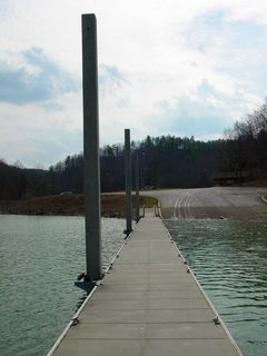 The dock is nothing fancy, but designed to be always available regardless of the water level, as it's designed to be flexible via hinges to ride any waves, and also to rise and fall with changing lake levels, as there are rollers on the points where it connects to the poles.