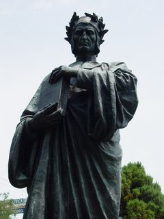 A statue of Dante Alighieri stands dressed in classical attire on the east side of the park.