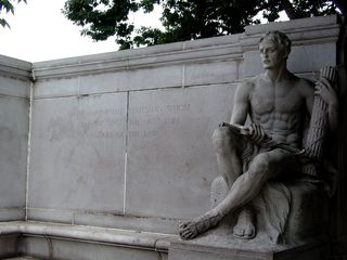 """Next to the female figure at left, the inscribed text provides the dates of his presidency in Roman numerals, while the inscribed text next to the male figure at right reads, """"The incorruptible statesman whose walk was upon the mountain ranges of the law."""""""