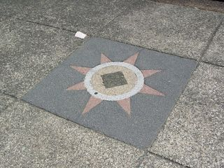 """In keeping with the """"Meridian Hill"""" concept (Thomas Jefferson had hoped that 16th Street in Washington, one of four """"Washington meridians"""", would become the global Prime Meridian), a number of compasses are set into the sidewalks."""