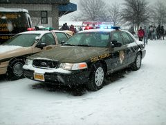 Maryland State Police Crown Victoria with its lights on. As the Maryland State Police was the sponsor of the event, their vehicles were plentiful.