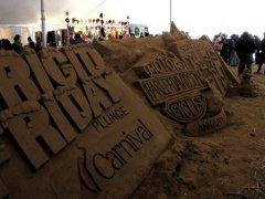Sand sculptures of plunge sponsor logos.