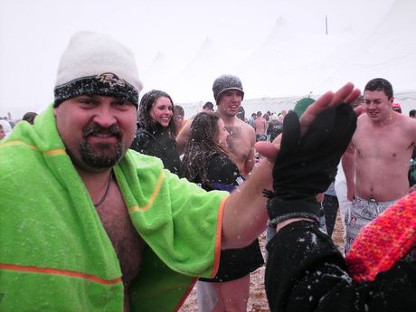 A man gives a high five after having taken the plunge.