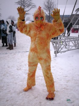 A man poses in a chicken suit following the cancellation of the 3:00 plunge.