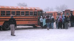 Participants board buses back to their satellite parking location.