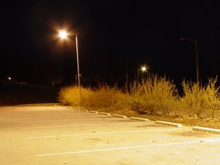 Lighting around the parking lot in front of the Discovery Center lends a star-shaped glow...