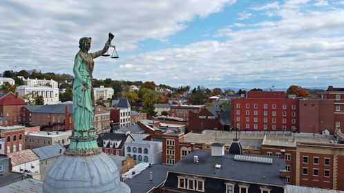 Statue of justice on top of the cupola of the Augusta County Courthouse in Staunton, Virginia.