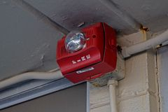 SpectrAlert Advance fire alarm horn/strobe mounted sideways at The Inn at Afton, a defunct motel on Afton Mountain in Virginia.