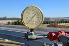 Water pressure gauge on the fire standpipe system in the parking garage at Dulles International Airport.