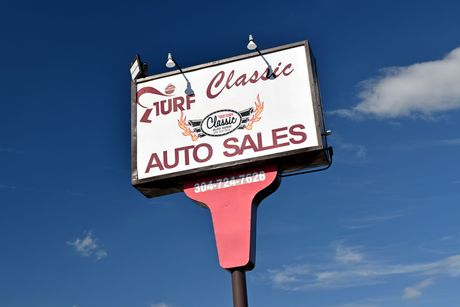 Sign for Turf Classic Auto Sales in Charles Town, West Virginia.