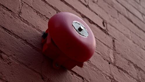 System Sensor fire alarm bell on the Augusta Street facade of 1 East Beverley Street in downtown Staunton, Virginia.