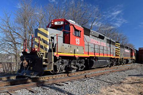 Buckingham Branch locomotive 13, waiting on a track near downtown Staunton, Virginia. Buckingham Branch locomotive 14 is immediately behind it.