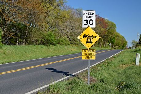 Speed limit and low ground clearance signs on Mountville Road in Frederick County, Maryland.