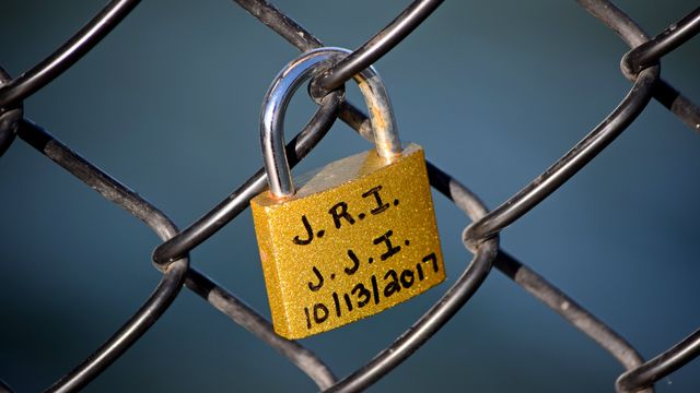 Love lock attached to the chain link fencing on the Ocean City Fishing Pier.