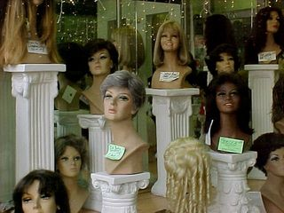 And now we reach the wig shop. Here they have hairpieces in modern styles...