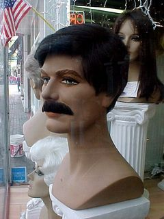 This mannequin is particularly interesting, being a woman mannequin, but wearing that big mustache...