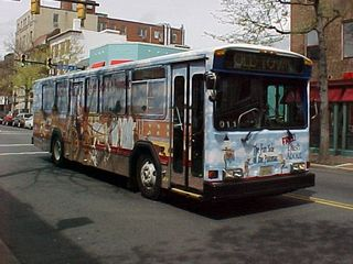 """And as we're walking past, the Dash About bus, advertising that this is the way to """"Dash About the fun side of the Potomac""""."""