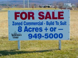 """At the time of my photo set, a """"for sale"""" sign was posted along Shenandoah Village Drive. Before the Outlet Village closed, this sign was replaced with a sign advertising the new Waynesboro Town Center."""