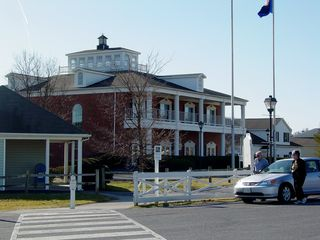 The Outlet Village's most prominent building was Building 1. Building 1 was the only two-story building, and also the only one to have a brick exterior. While one would think that it would have been used to house a department store or similar anchor store, it never did. In earlier years, it housed a small eatery. Later, as stores left and non-traditional organizations began leasing space, this building housed the Artisans Center of Virginia.