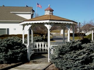 In this section of the Outlet Village, a gazebo existed, providing seating for patrons.