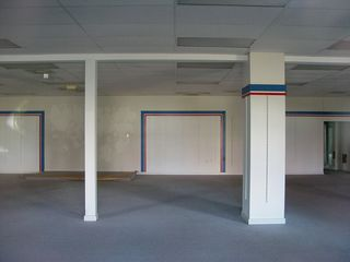 A look through a window in Building 4 revealed an empty store. It is unknown who once occupied this space.