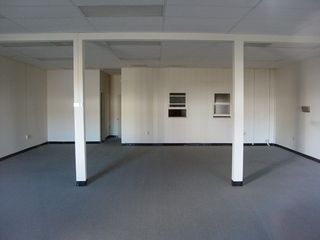 7F, the former Borg-Warner office, is now empty and devoid of life. The only indication of this space's use as an office is a small mailbox on the right wall.