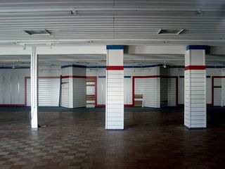 One store in Building 13 that lasted into the mid-1990s was the Bugle Boy outlet, whose former space is like most of the others - dark and empty.