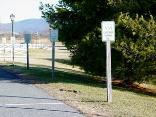 This area was originally designed for buses to load and unload passengers, but with the arrival of Virginia Metalcrafters, the area was divided up for use as parking for Virginia Metalcrafters customers. This made Virginia Metalcrafters the only store where people could park right by the door.