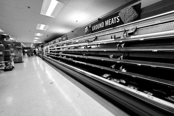 Empty shelves in the meat department of a Giant Food store in McLean, Virginia, as people prepared for lockdowns in the same way that they would for an impending winter storm.