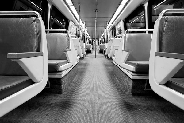 Interior of railcar 3243 on the Orange Line of the Washington Metro. This car would normally be full to standing room at this hour of the day, but due to a sharp drop in ridership brought on by the pandemic response, the car was empty.